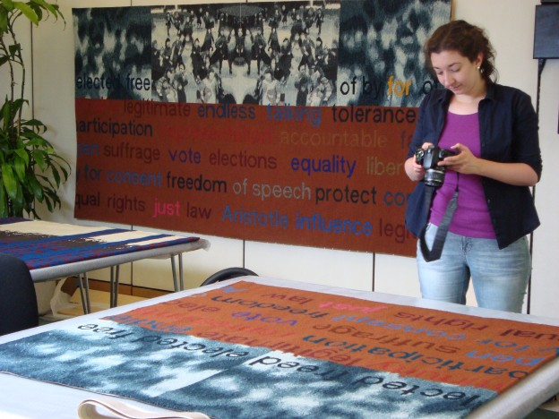 Image of student photographing a tapestry