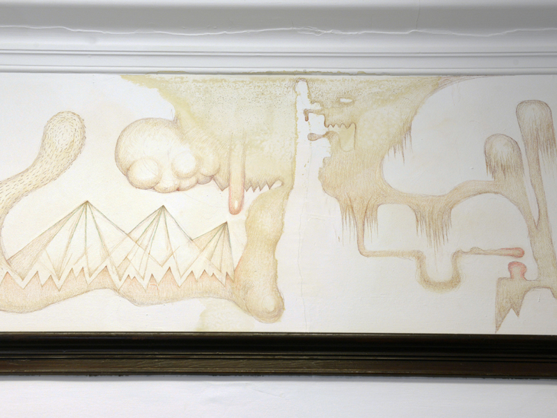 Abstract drawings by artist Fritz Welch in pencil and ink on the wall of a room