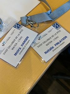 A photo of Moira and Natalie's lanyards on a table at the conference