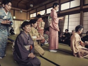 Women in traditional Japanese dress sitting on tatami at the Res Artis conference in Kyoto, Japan